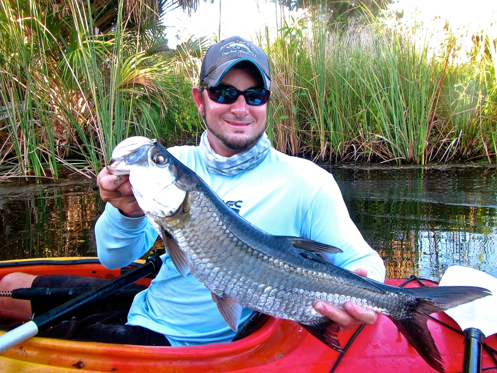 Capt. Casey with a Baby Tarpon